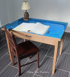 Solid wood desk and chair.  Desk painted in Annie Sloan Honfleur, with a poured resin top full of sparkle in blues and greens.  Perfect for a boys room.  $275 Can or $215 US