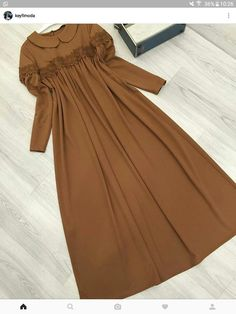 Russet brown, tan color, maxi dress, floor length, muslimah hijab outfit, feminine classy vintage Modern Hijab Fashion, Abaya Fashion, Modest Fashion, Fashion Dresses, Women's Fashion, Fashion Trends, Hijab Style Dress, Hijab Outfit, Moslem Fashion