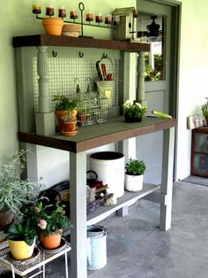 My husband made this garden potting bench out of a pallet other scrap wood and old furniture legs.