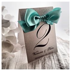 Silver glitter table number with Tiffany Blue Ribbon table number on Etsy, $4.44 CAD