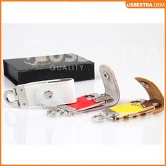 Showcasing white, red and yellow casing fdr-055 leather USB stick.  http://www.usb-extra.co.uk/products-leather-usb-drives.html