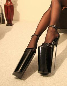 66d4e5c24 Very tall heels... I would die if I wore those and I wonder