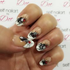 Halloween nailart. Spider water decal on French tip with red rhinestones nailart.
