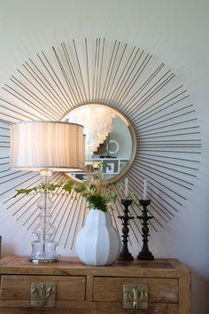 Contemporary vignette with sunburst mirror, glass lamp and vase with green clippings on a wooden chest Home Interior Design, Home Design, Design Ideas, Design Minimalista, Sunburst Mirror, False Ceiling Design, Do It Yourself Decorating, Decorating Ideas, Birch Lane