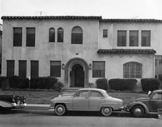 Exterior of a Spanish style apartment building, located at 636 S. Dunsmuir Avenue, as seen from across the street. Photograph dated November 23, 1962.