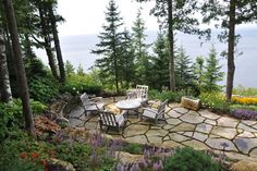 Irregular flagstone is pieced together like a puzzle for a natural patio.