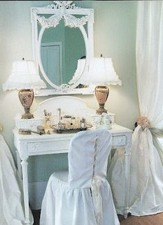 Beautiful make up table.  Love the slip cover and lamps.  The silk drapes are billowy and dreamy!!