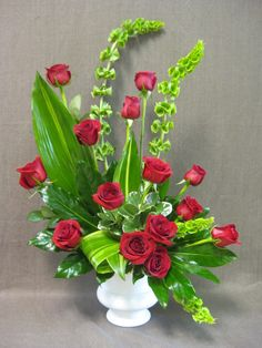 Funeral arrangement of roses. #funeralflowers