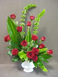 Funeral arrangement of roses. #funeralflowers