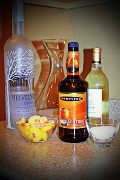 Peach Sangria  2 peaches.  You can use frozen ones  1 cup vodka 1/2 cup peach schnapps 1 bottle white wine (I use Sauvignon Blanc) 1/2 cup sugar. Sprite. soak peaches in vodka & schnapps in pitcher 1hr. add the bottle of wine and sugar.  Mix until sugar dissolves.   Fill remainder of the pitcher with Sprite.