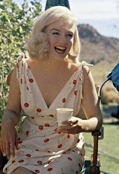 The beautiful Marilyn Monroe enjoying a cup of coffee.