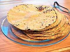 Papadum is an Indian and Sri Lankan flatbread recipe on Recidemia. Typically, it is prepared using black gram bean flour, rice flour, or lentil flour with salt and peanut oil added. The ingredients are made into a dough and formed into a thin, round shape similar to a tortilla. As the dough is prepared, the papadum can be seasoned with a variety of different ingredients such as chilies, cumin, garlic, black pepper, or other spices.