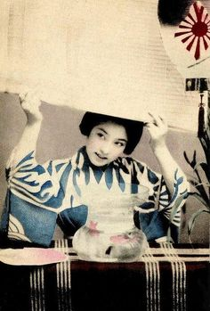 GEISHA WITH A GOLDFISH BOWL, LOWERING A BLIND -- A Parting Smile at the End of the Day by Okinawa Soba, via Flickr