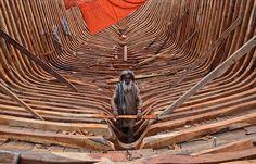A Pakistani carpenter works on a fishing boat at the harbor of Karachi, Pakistan, Monday, June 25, 2012. (AP Photo/Shakil Adil)