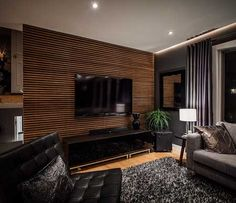 33 modern TV wall panel designs and models modern living room black with tv wanpaneel wood and black pieces of furniture Tv Wall Panel, Wall Panel Design, Tv Wall Design, House Design, Wall Tv, Panel Walls, Modern Ceiling Design, Design Room, Accent Walls In Living Room