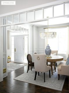 Gorgeous dining room with grey walls, moldings, crystal chandelier. Beautiful spring decor featuring blue and white chinoiserie. Elegant Dining Room, Dining Room Design, Dining Rooms, Dining Area, Interior Decorating, Interior Design, Interior Ideas, Decorating Ideas, Decor Ideas