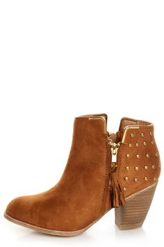 Check it out from Lulus.com! Mayday! Mayday! This is a cute boot emergency! We don't think we can live without these Dollhouse Mayday Chestnut Studded Ankle Boots! The tan vegan suede upper is here to save us, with a gold-studded heel, decorative outside zipper with a tassel pull, and gold metal tips on the collar corners. 2.75