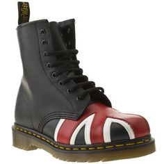 Doc Martens shoes were worn by both sexes in the 1980s. They were an essential fashion accessory for the skinhead and punk subcultures in the United Kingdom. Sometimes Doc. Martens were paired with miniskirts or full, Laura Ashley- style dresses.