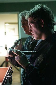 William Petersen and Eric Szmanda in CSI: Crime Scene Investigation (2000)