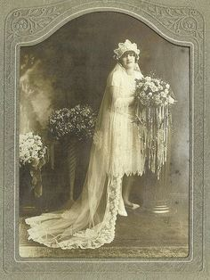 "What a hefty bouquet! From ""12 Beautiful Vintage Photos Of Brides From 1850-1920s."""