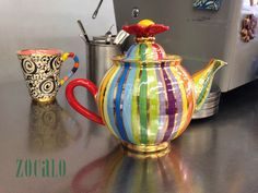 Colorful and eccentric teapot and cup! Mary Rose Young collection!