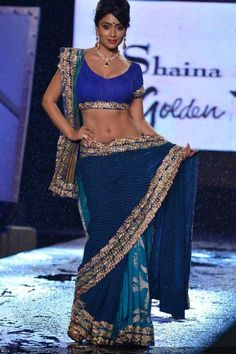 Shriya Saran raises the temperatures as she walks the ramp in Shaina NC creation during the 8th Caring with Style fashion show, organised by Fevicol for Cancer Patients Aid Association (CPAA), in Mumbai, on June 2, 2013.