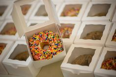 donut wedding favors - ours will be Krispy Kreme in double boxes with stickers on them. To place at place setting.  Or do you have a table we can place them?
