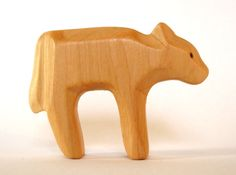 Long I tried to find the typical gesture of a calf. Here is it. I think it is cute, but not funny. It is handmade from wood (alder), carved,