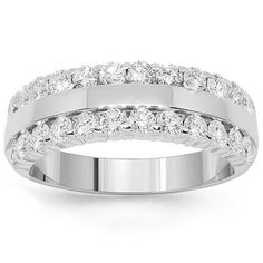 This glamorous womens diamond wedding band is crafted in lustrous 14K white gold. Brilliant round cut diamonds are placed half way around the band and total to 1.07 carats. The frame measures to 1/4 inches in width and weighs approximately 7.1 grams. This lovely womens diamond wedding band is an ideal gift for that special occasion. $1,913.00