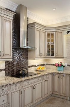 kitchen backsplash ideas - Handmade tiles can be colour coordinated and customized re. shape, texture, pattern, etc. by ceramic design studios