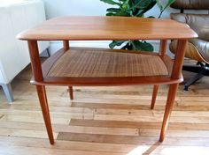 Don't know how I feel about the wicker, but I love the shape.     Peter Hvidt Teak Occasional Table for France & Son. $460.00, via Etsy.