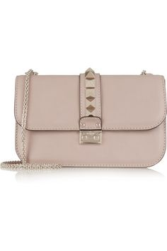 In a versatile blush hue, Valentino's 'Lock' bag is a modern-day classic. This structured design has pale-gold hardware and signature hand-embellished pyramid studs. An interior zipped pocket keeps small essentials secure. Carry it by the adjustable chain strap against a skirt and chambray shirt.