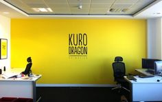 an impact in their mainly white office a warm yellow feature wall ...