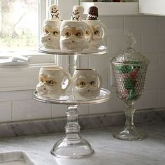 Such a cute idea to display holiday mugs on a cupcake stand!