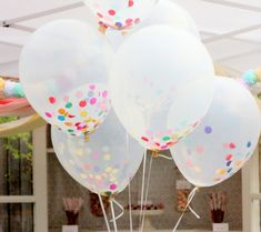 Polka Dot Balloons. So cute. Could probably put puff balls in them too but may not float.