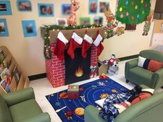 My preschool class is all decorated for Christmas! : Teachers haha yeah, we took cardboard boxes and wrapped them with brick wrapping paper. The fireplace itself is just black paper and we cut a fire out of different construction paper. Easy