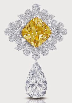 """The Royal Star of Paris, a brooch (which also can be worn as a pendant) has two diamonds of at least 100 carats each: the """"Graff Sunflower,"""" a 107.46-carat fancy yellow cushion cut diamond and the """"Graff Perfection,"""" a 100-carat D flawless pear shape diamond drop."""
