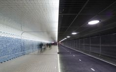 Contrast for bicycles and pedestrians in tunnel Amsterdam Central Station- by Benthem Crouwel Architects