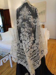 CIRCA 1860's, ORNATE BRUSSELS LACE APPLIQUE LACE SHAWL W/POINT DE GAZE. A large triangular Brussels bobbin lace a...