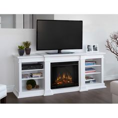 Real Flame W White Fan-forced Electric Fireplace at Lowe's. Enjoy the beauty of a Real Flame electric fireplace, this substantial freestanding fireplace also doubles as an entertainment center. White Tv Stands, Cool Tv Stands, Tv Stand Canada, Media Fireplace, Gel Fireplace, Fireplace Ideas, Fireplace Modern, Fireplace Decorations, White Fireplace