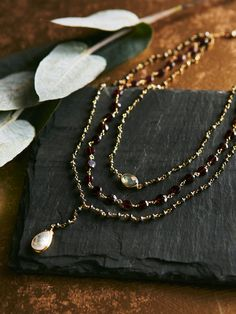 Three in One Layered Garnet Pyrite Rosary | Gorgeous multi-tier lariat style necklace features semi-precious stone detailing. Each chain strand features a different color stone. Adjustable lobster clasp closure. American made.