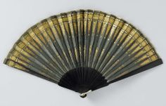 "Folding fan, anoniem, c. 1800 - c. 1810 - Rijksmuseum. ""Following Napoleon Bonaparte's appointment as the 'First Consul' of France on 10 November 1799, fashion, under his influence, was increasingly dominated by Classical antiquity. This fan is a good example, with its gilt copper punched decorations of sheaves of arrows and stacked foliate and floral ornaments."""