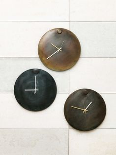 The NOW clock in three different patinated finishes.