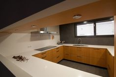 SANTOS kitchen. Proyecto de Clysa. Modelo Marina Arce Coñac.