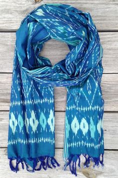 This lovely lightweight natural cotton Caribbean Dreams Winter Ikat Scarf features tassels and pairs well with work or play attire. #HandDyed #EthicalFashion