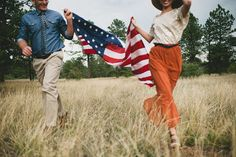 Patriotic engagements with a flag by Blush Photography
