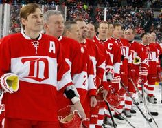 Detroit Red Wing alumni Sergei Fedorov and other alumni line up for the national anthem to start the second game at the Alumni Showdown between the Detroit Red Wings and Toronto