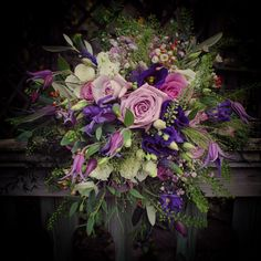 Jewel toned bouquet. Armando and Cool Water Roses, Clematis, Veronica, Lisianthus & Waxflower