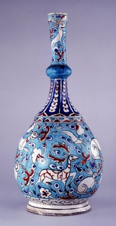 Bottle. Grotesque animal hunt and confronted harpies. Made of black, turquoise, green, red (bole), cobalt painted and glazed ceramic, pottery.bottle; Ottoman dynasty; 17thC; Iznik
