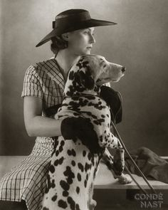 This is kind of like the coolest photo of an unknown woman and her Dalmation...I shall call them Sarah M. and Dolly.